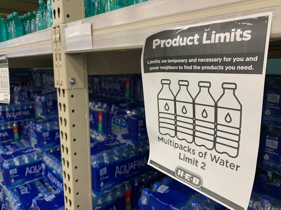 """A """"Product Limits"""" sign appears on water shelves in a Houston supermarket on Feb. 20, following a winter storm that left millions without power and caused water pipes to burst. (Photo: FRANCOIS PICARD/AFP/Getty Images)"""