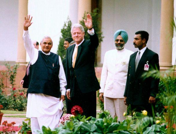 PHOTO: President Bill Clinton, center, and Indian Prime Minister Atal Bihari Vajpayee wave from Hydrabad House in New Delhi, India, March 21, 2000. (T.c. Malhotra/Getty Images, FILE)