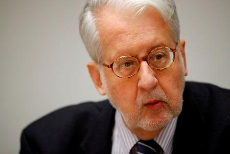 FILE PHOTO: Paulo Pinheiro, chairman of the U.N. Commission of Inquiry on Syria, attends the launch of a report on sexual and gender-based violence in Syria at the United Nations office in Geneva, Switzerland, March 15, 2018.  REUTERS/Denis Balibouse/File Photo