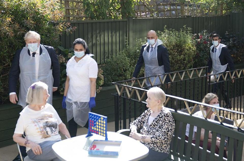 Prime Minister Boris Johnson (second left), Health Secretary Sajid Javid and Chancellor of the Exchequer Rishi Sunak (right) talk to residents Doreen (left) and Janet during a visit to Westport Care Home in Stepney Green, east London (Paul Edwards/The Sun) (PA Wire)