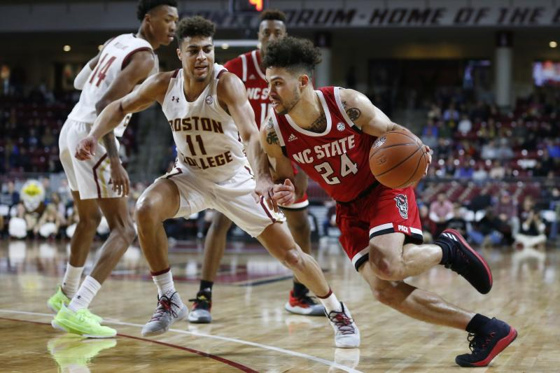 North Carolina State's Devon Daniels (24) drives past Boston College's Derryck Thornton (11) during the second half of an NCAA college basketball game in Boston, Sunday, Feb. 16, 2020. (AP Photo/Michael Dwyer)