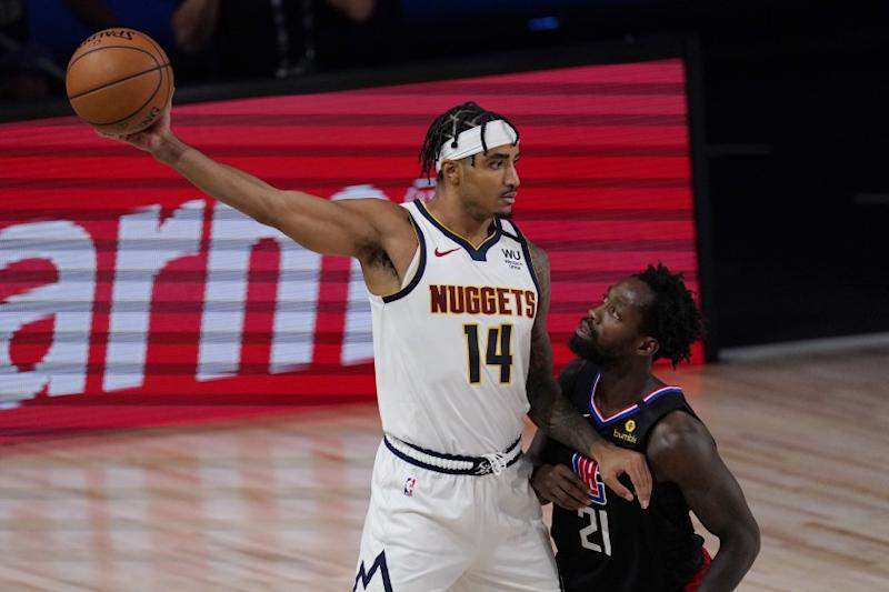Denver Nuggets' Gary Harris (14) keeps the ball from Los Angeles Clippers' Patrick Beverley (21) in the second half of an NBA conference semifinal playoff basketball game Thursday, Sept 3, 2020, in Lake Buena Vista Fla. (AP Photo/Mark J. Terrill)