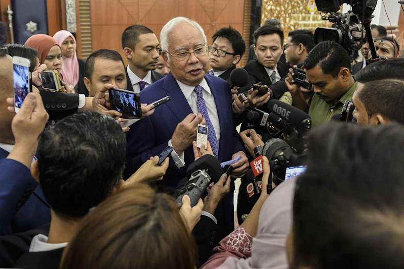 Najib's trial today ended earlier to allow him to join in the parliamentary debates and voting, as the judge recognised the importance of the Undi 18 Bill. ― Picture by Miera Zulyana
