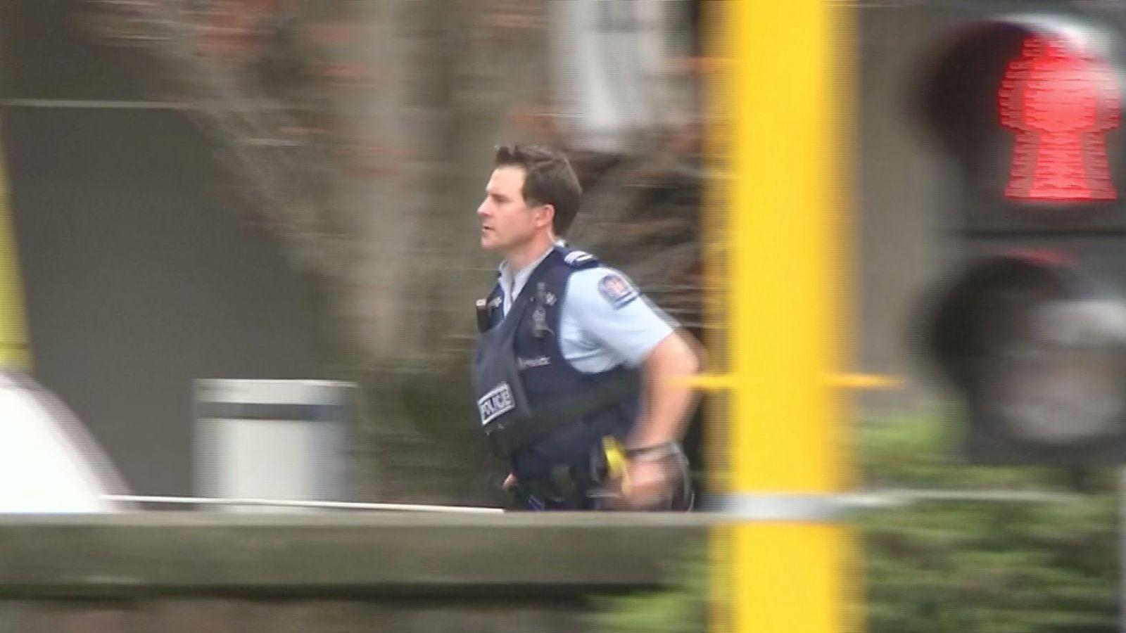 A police officer attends the scene of a mass shooting in Christchurch