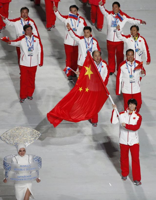 China's flag-bearer Tong Jian leads his country's contingent during the opening ceremony of the 2014 Sochi Winter Olympics, February 7, 2014. REUTERS/Lucy Nicholson (RUSSIA - Tags: OLYMPICS SPORT)