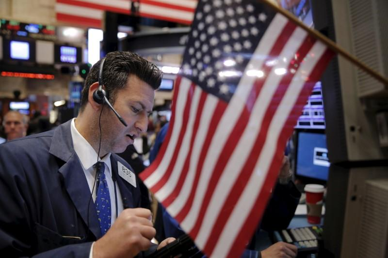A trader works shortly after the opening bell on the floor of the New York Stock Exchange in the Manhattan borough of New York