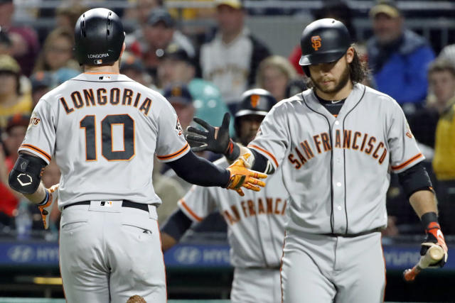 San Francisco Giants' Evan Longoria (10) is greeted by Brandon Crawford after hitting a solo home run off Pittsburgh Pirates starting pitcher Chad Kuhl during the second inning of a baseball game in Pittsburgh, Saturday, May 12, 2018. (AP Photo/Gene J. Puskar)