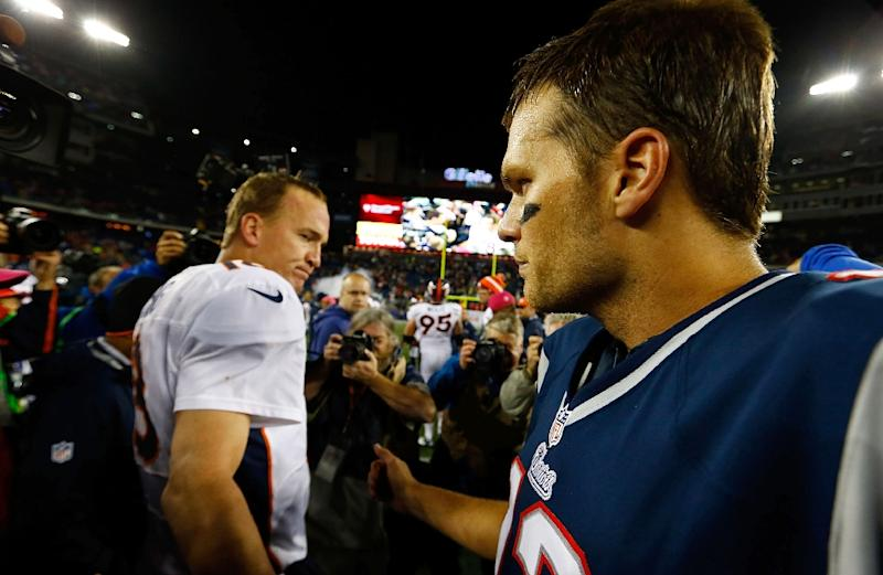 Tom Brady of the New England Patriots and Peyton Manning of the Denver Broncos greet each other at midfield following a game in October 2012