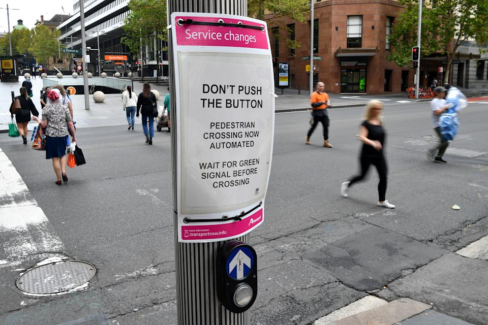 A City of Sydney notice about automated pedestrian crossings at Martin Place in Sydney, Tuesday, March 24, 2020.