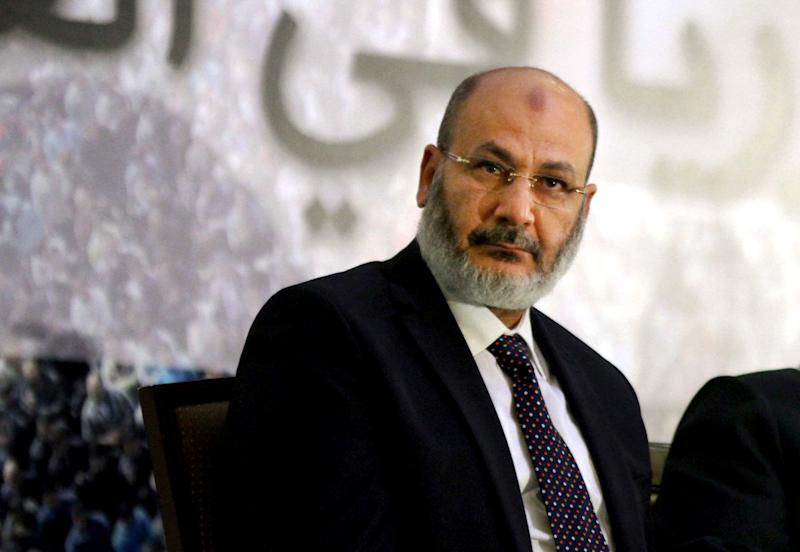 In this Thursday, June 13, 2013 photo, cleric Safwat Hegazy, a Muslim Brotherhood ally, attends a news conference with Muslim scholars, in support of Syria, in Cairo. On Wednesday, Aug. 21, 2013, Hegazy, a fiery preacher from the ultraconservative Salafi movement and a top Brotherhood ally, was captured at a checkpoint near the Siwa Oasis in eastern Egypt and close to the border with Libya, according to the state-run MENA news agency. The cleric is wanted on charges of instigating violence. (AP Photo/Ahmed Gomaa)