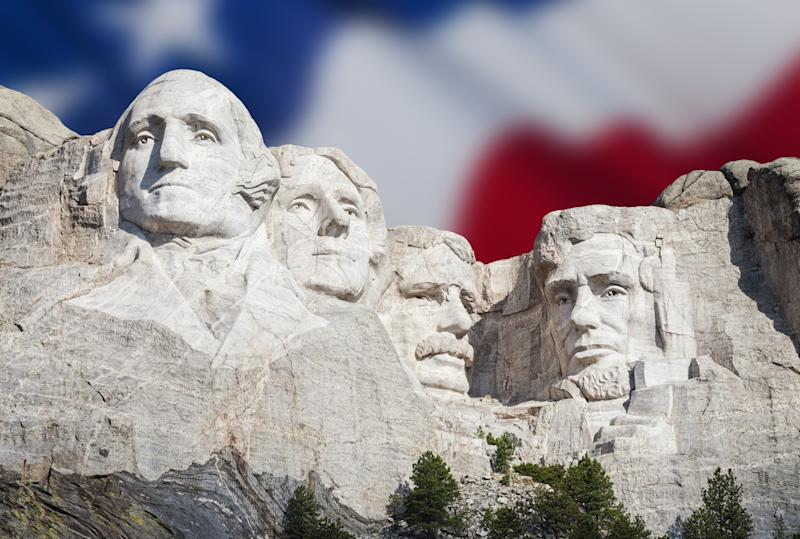 USA, South Dakota, Black Hills, Mount Rushmore National Memorial with American flag in the background