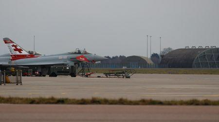 FILE PHOTO:  Eurofighter Typhoon aircraft are seen on the apron at RAF Coningsby in Lincolnshire, Britain