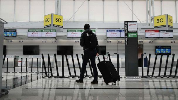 PHOTO: A traveler walks though a nearly-empty international terminal at O'Hare Airport on March 12, 2020, in Chicago. (Scott Olson/Getty Images)