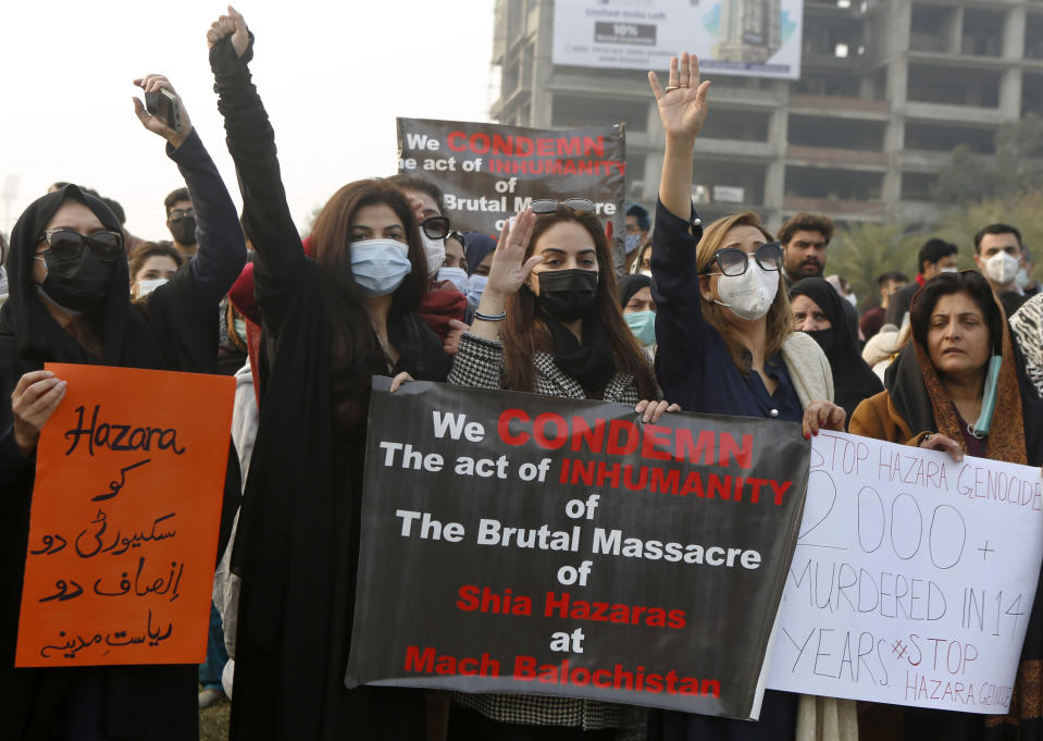 Supporters of a civil society organization hold a demonstration to protest the killing of coal mine workers by gunmen near the Machh coal field, in Lahore, Pakistan, Thursday, Jan. 7, 2021. Pakistan's minority Shiites continued their sit-in for a fifth straight day insisting they will bury their dead only when Prime Minister Imran Khan personally visits them to assure protection. (AP Photo/K.M. Chaudary)