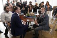 """Britain's Chancellor of the Exchequer George Osborne (C) and French Economy Minister Emmanuel Macron (R) visit the so-called """"incubator"""" of French high-tech start-ups """"TheFamily"""" with Oussama Ammar (L), co-Founder of TheFamily Accelerator, in Paris, France, July 27, 2015. REUTERS/Charles Platiau"""