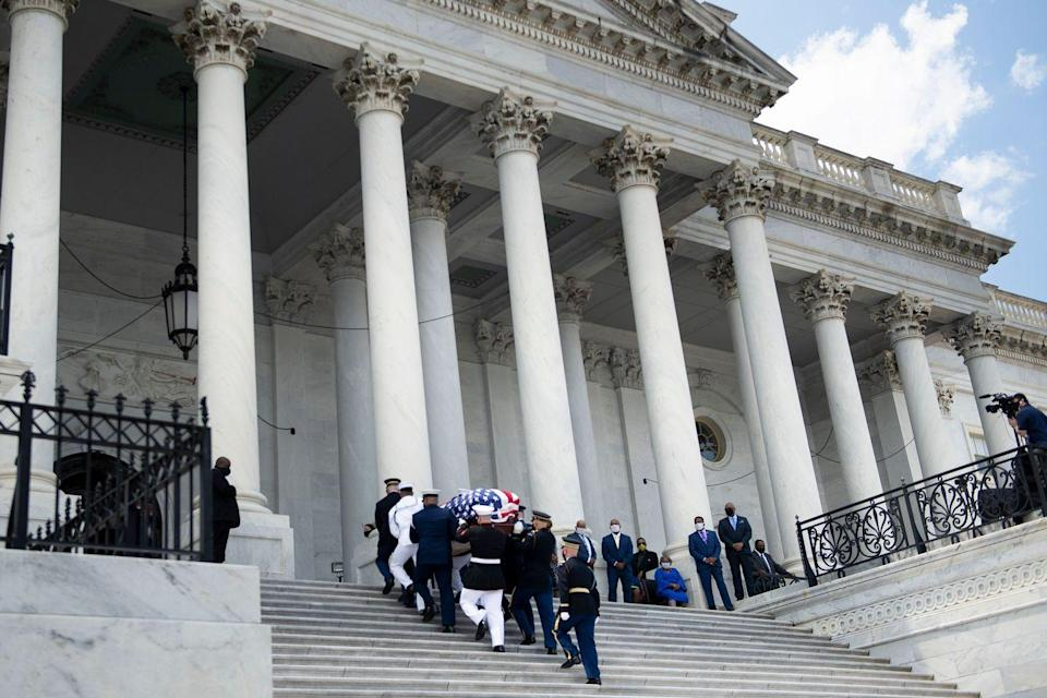 <p>Onlookers watched as Lewis's flag-draped casket was walked into the Capitol building by a joint services military honor guard. Lewis served Georgia's 5th congressional district from 1987 until his death.</p>