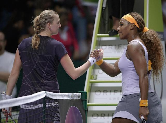 Petra Kvitova of Czech Republic, left, and Serena Williams of the USA clasp hands after their tennis match at the WTA championship in Istanbul, Turkey, Thursday, Oct. 24, 2013. The world's top female tennis players compete in the championships which runs from Oct. 22 until Oct. 27.(AP Photo)