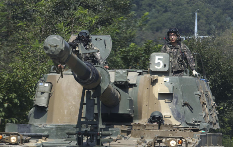 South Korean army soldiers drive a K-55 self-propelled howitzer during a military exercise in Paju, South Korea, near the border with North Korea. (AP Photo/Ahn Young-joon)