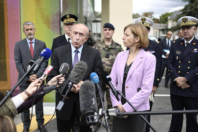<p>French Interior Minister Gerard Collomb (C) speaks to the press next to French Defence Minister Florence Parly (R) after meeting with soldiers wounded in an attack this morning in Levallois-Perret at the Begin Military Teaching Hospital in Saint-Mande, outside Paris, on August 9, 2017. Photo: Stephane de Sakutin/AFP/Getty Images) </p>