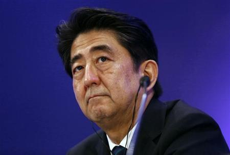 Japan's PM Abe attends a business meeting organised by Confederation of Indian Industry in New Delhi