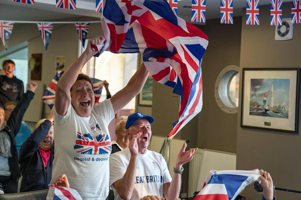 Celebrations erupt at Hollingworth Lake Sailing Club, near Rochdale (Peter Byrne/PA) (PA Wire)