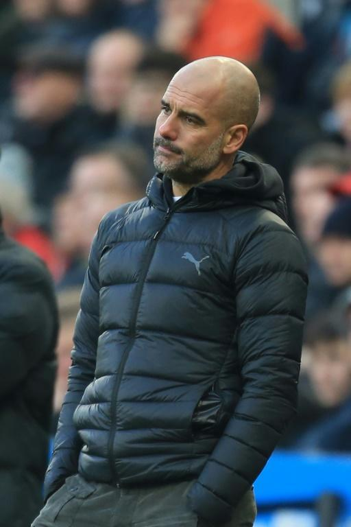 Pep Guardiola's Manchester City are now 11 points behind Liverpool (AFP Photo/Lindsey Parnaby)