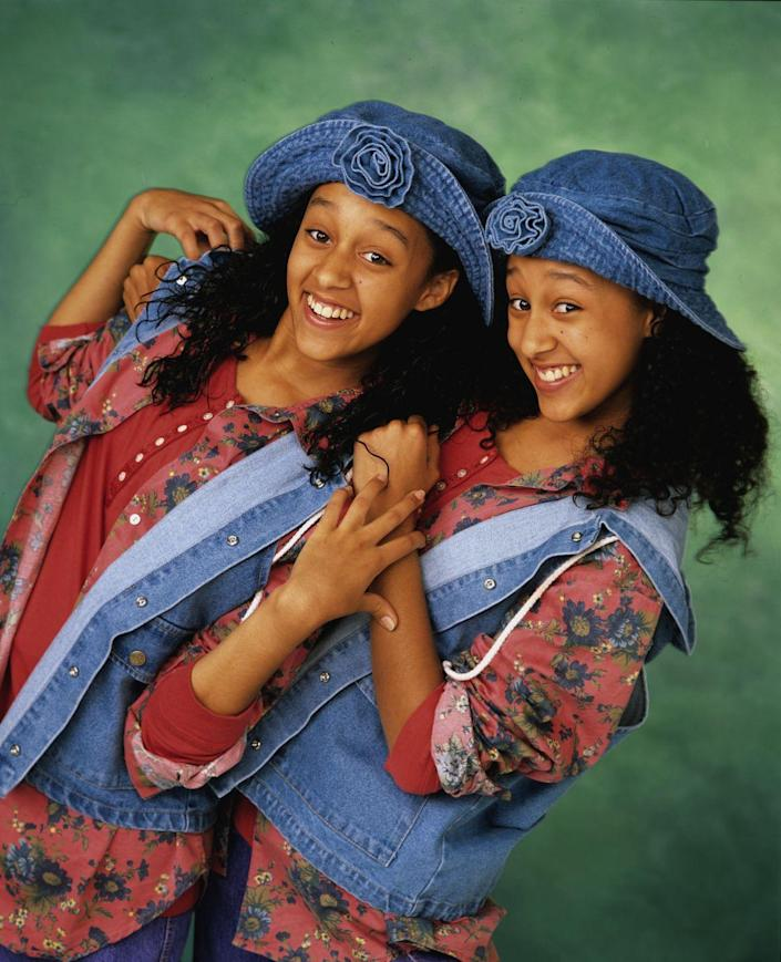 """<p>Hollywood's long fascination with twins strikes again when real-life teenage twins Tamera and Tia earned their own TV series, <em><a href=""""https://www.amazon.com/Sister-Complete-Collection-Jackee-Harry/dp/B018UXFXQE?tag=syn-yahoo-20&ascsubtag=%5Bartid%7C10050.g.24736857%5Bsrc%7Cyahoo-us"""" rel=""""nofollow noopener"""" target=""""_blank"""" data-ylk=""""slk:Sister, Sister"""" class=""""link rapid-noclick-resp"""">Sister, Sister</a></em>. The show was about, well, what else? Twins separated at birth who are later reunited. It was a hit that lasted six seasons, followed by a grown-up reality series that traced their adventures as moms, wives, and actresses. </p>"""