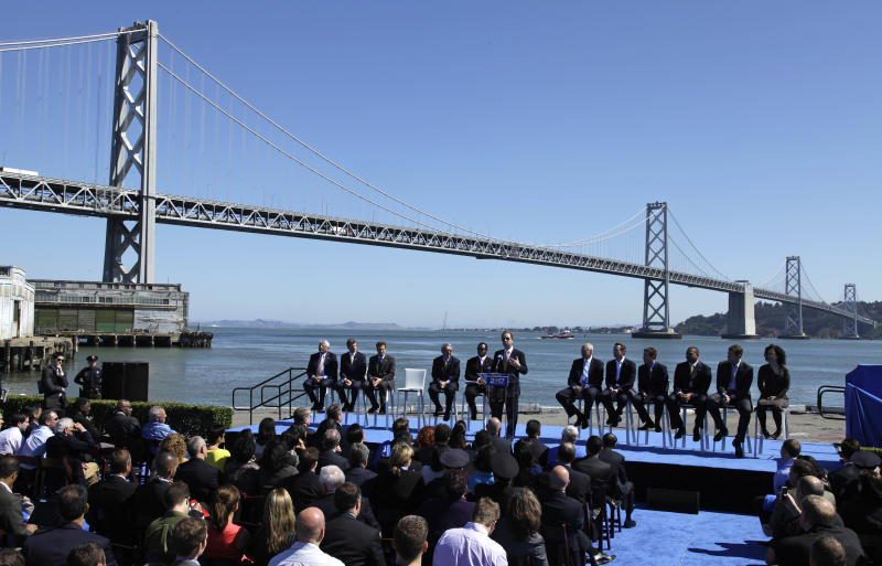 Golden State Warriors owner and CEO Joe Lacob, at podium, speaks during an announcement, Tuesday, May 22, 2012, in San Francisco, that the NBA basketball team wants to build a new arena on the waterfront in San Francisco. The Warriors unveiled plans to build an arena at Piers 30-32. The waterfront site is just blocks from the San Francisco Giants' ballpark and the downtown financial district. The arena is expected to be completed by 2017. (AP Photo/Eric Risberg)