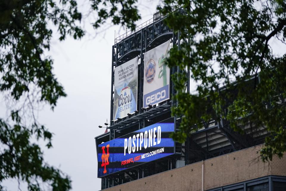 A billboard at CitiField announces the postponing of a baseball game Friday, May 28, 2021, in New York. The game between the Atlanta Braves and the New York Mets was postponed due to inclement weather. (AP Photo/Frank Franklin II)