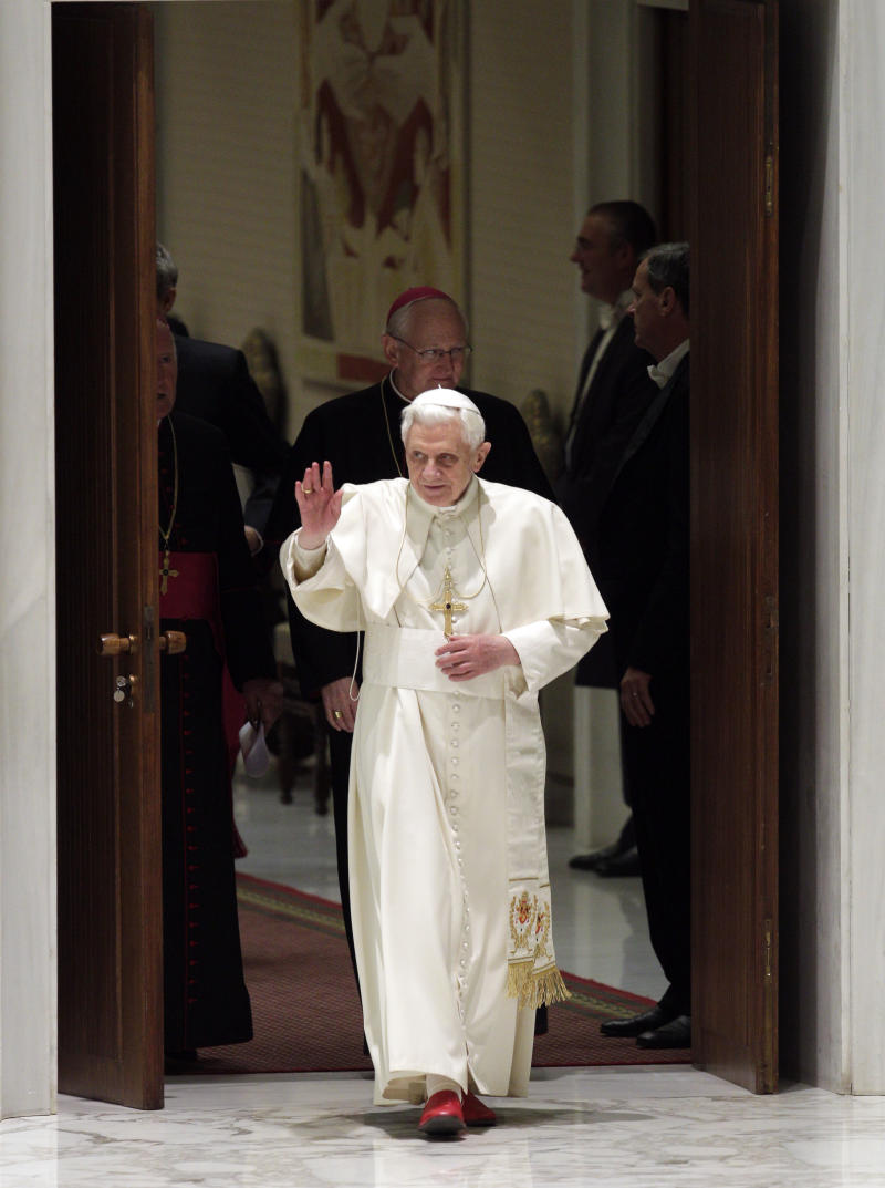 Pope Benedict XVI delivers his blessing as he arrives in the Paul VI hall for the weekly general audience at the Vatican, Wednesday, Jan. 19, 2011. (AP Photo/Andrew Medichini)