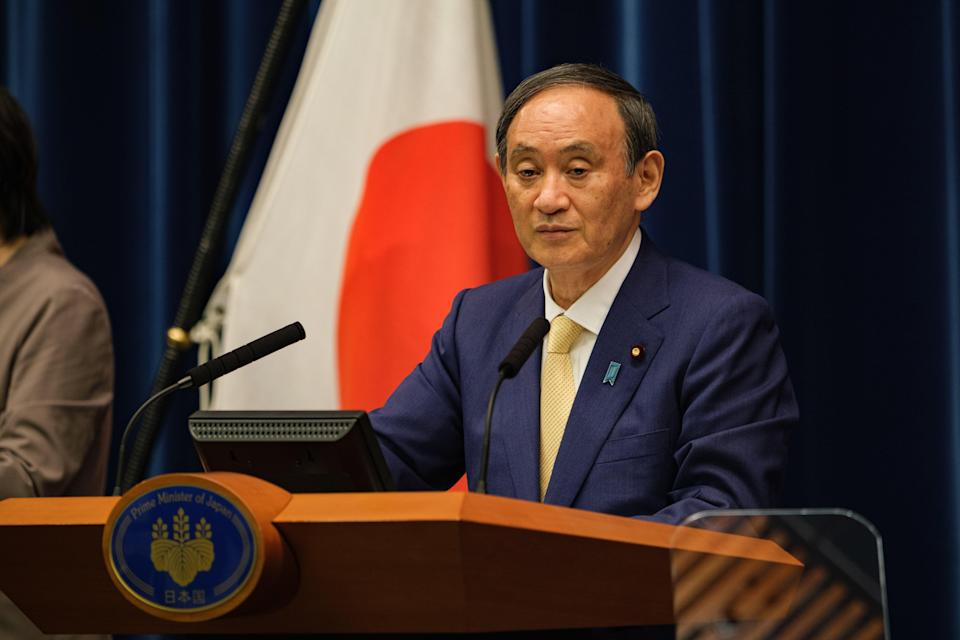 Japan's Prime Minister Yoshihide Suga speaks during a press conference about the Tokyo Olympics (Getty Images)