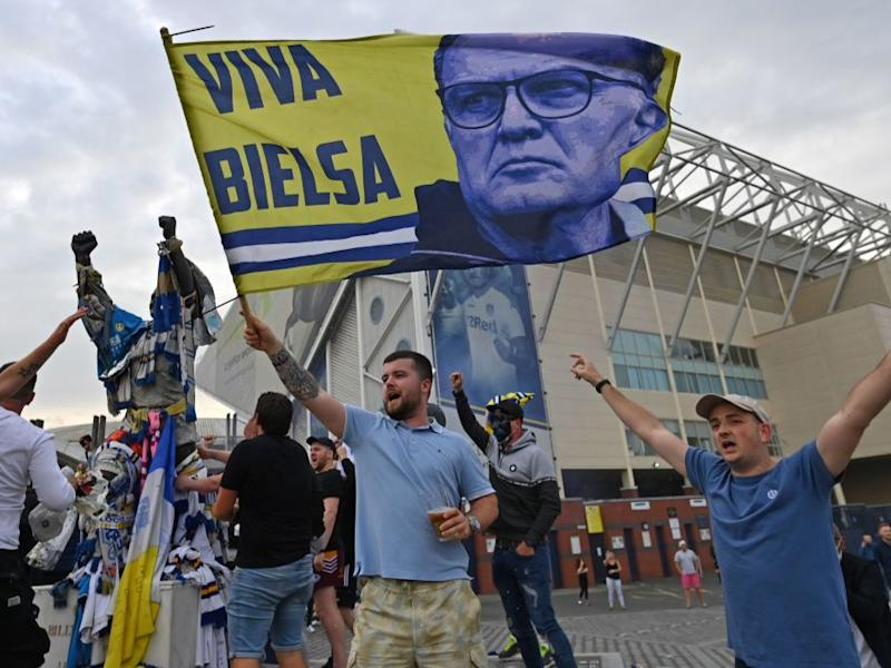 Leeds supporters celebrate promotion to the Premier LeagueAFP via Getty Images