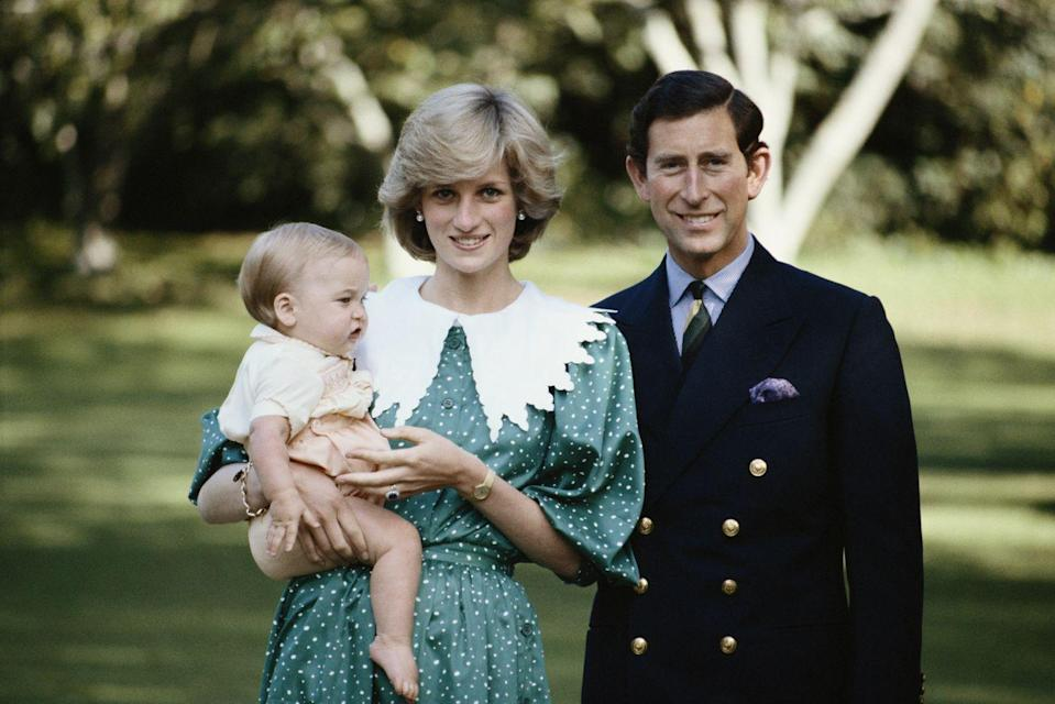<p>In a royal portrait with Prince Charles and Prince William. </p>