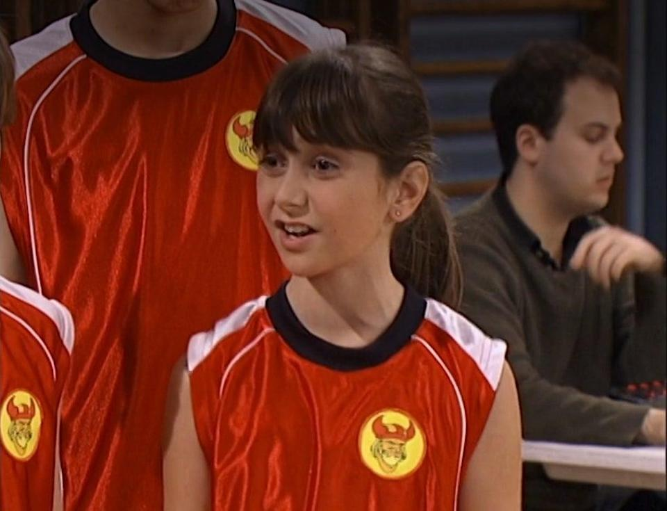 Alyson Stoner in a basketball jersey