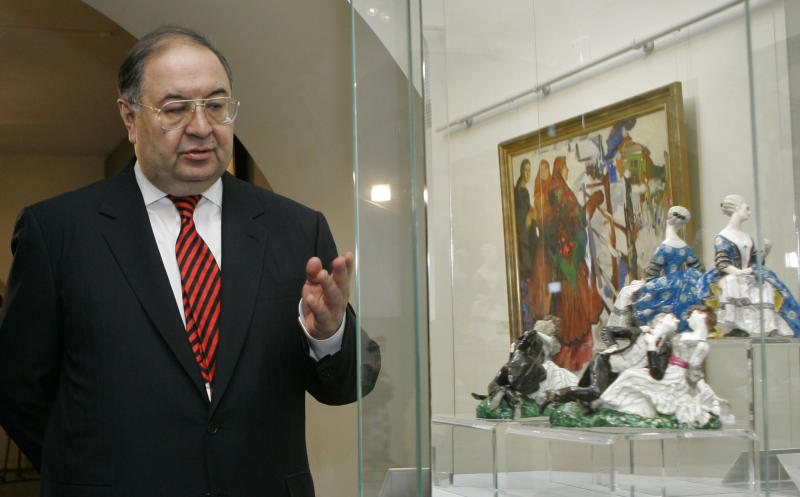 FILE- In this May 18, 2008, file photo, Russian billionaire Alisher Usmanov stands near pieces from the art collection of late cellist Mstislav Rostropovich and his wife Galina Vishnevskaya in the Konstantin Palace outside St. Petersburg, Russia. An ethnic Uzbek, Usmanov is perhaps the most successful native of ex-Soviet Central Asia to make a fortune in Russia. The old Moscow is rapidly giving way to a multi-ethnic city where Muslims from Central Asia are the fastest growing sector of the population. (AP Photo/Dmitry Lovetsky, File)