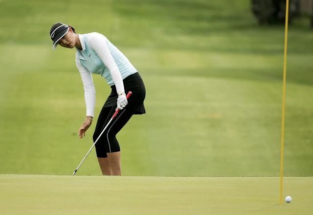 Michelle Wie reacts to her chip on the 15th hole during the second round at the Kraft Nabisco Championship golf tournament Friday, April 4, 2014, in Rancho Mirage, Calif. (AP Photo/Chris Carlson)