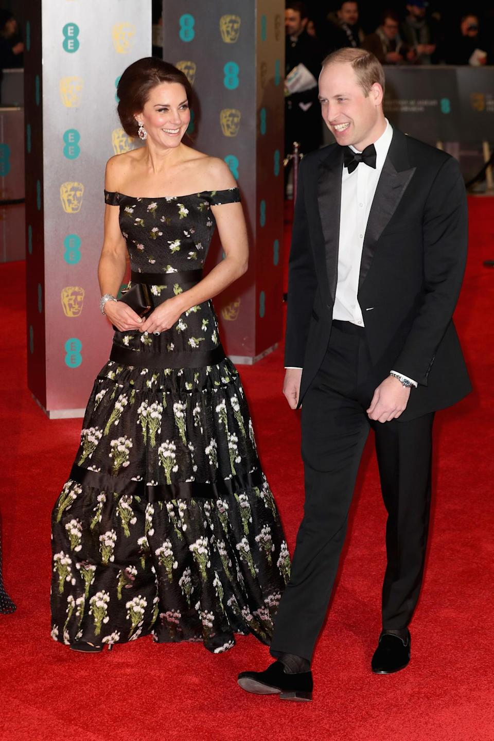 <p>For the 2017 BAFTAs, Kate chose a rather gothic gown by Alexander McQueen. The dress was printed with flowers and designed in an off-the-shoulder style. The Duchess paired the dark ensemble with black pumps and a matching satin McQueen clutch. </p><p><i>[Photo: Getty]</i></p>