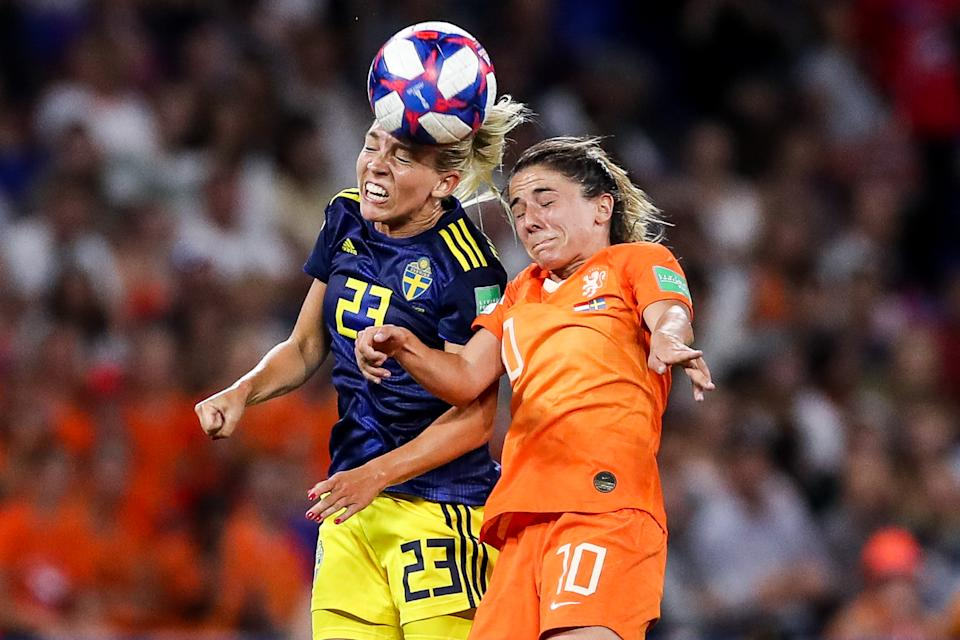 Elin Rubensson of Sweden competes for the ball with #10 Danielle Van De Donk of Netherlands during the 2019 FIFA Women's World Cup France Semi Final match between Netherlands and Sweden at Stade de Lyon on July 03, 2019 in Lyon, France. (Photo by Zhizhao Wu/Getty Images)