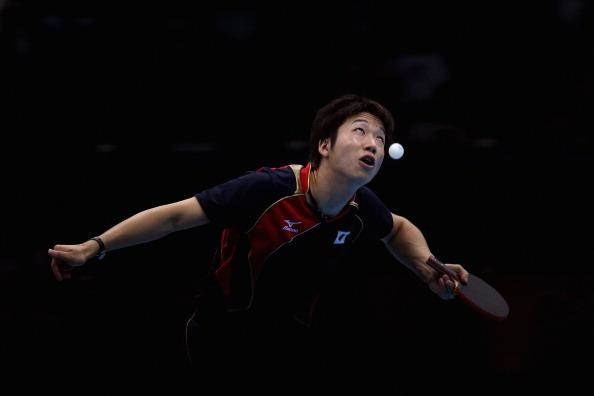 LONDON, ENGLAND - AUGUST 05:  Jun Mizutani of Japan completes during Men's Team Table Tennis quarterfinal match against team of Hong Kong, China on Day 9 of the London 2012 Olympic Games at ExCeL on August 5, 2012 in London, England.  (Photo by Feng Li/Getty Images)