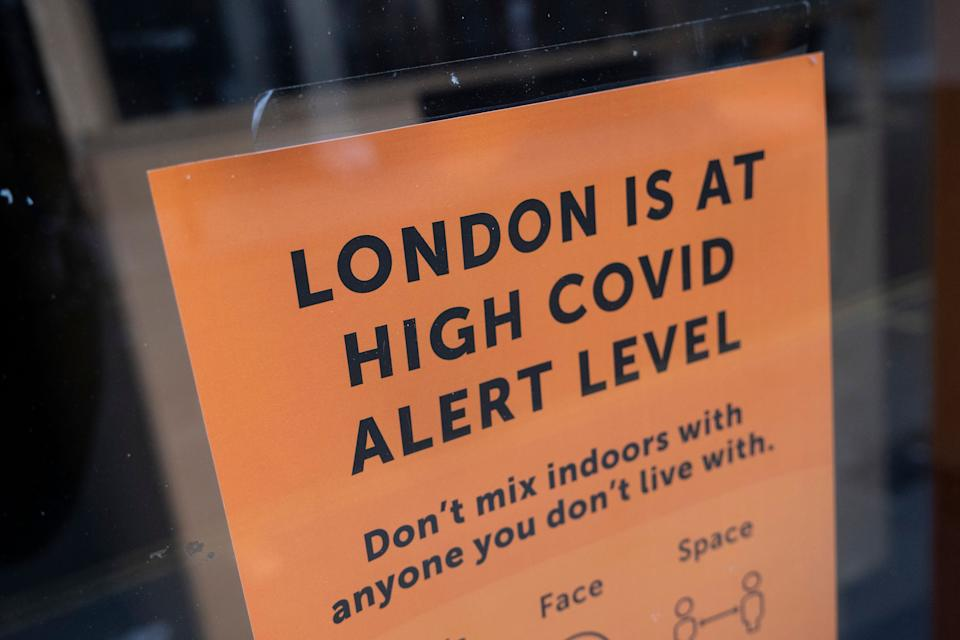 London is at high Covid alert level sign in a shop window  (Photo: Mike Kemp via Getty Images)