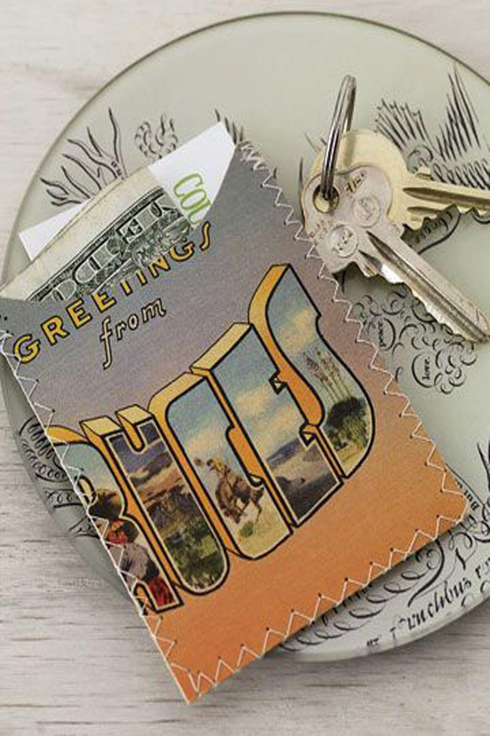 <p>Stitch up vintage postcards to make a slim wallet or business card holder.</p><p>Here's how: Fold the postcard in half with the decorative side face up, and cut a half-moon from the top front of the postcard. Open the card flat and cover with a sheet of clear, lightweight vinyl; stitch all around the postcard, 1/4-inch from its edge. Trim vinyl to fit and refold the postcard in half. Sew the wallet around three edges, leaving the top open.</p>