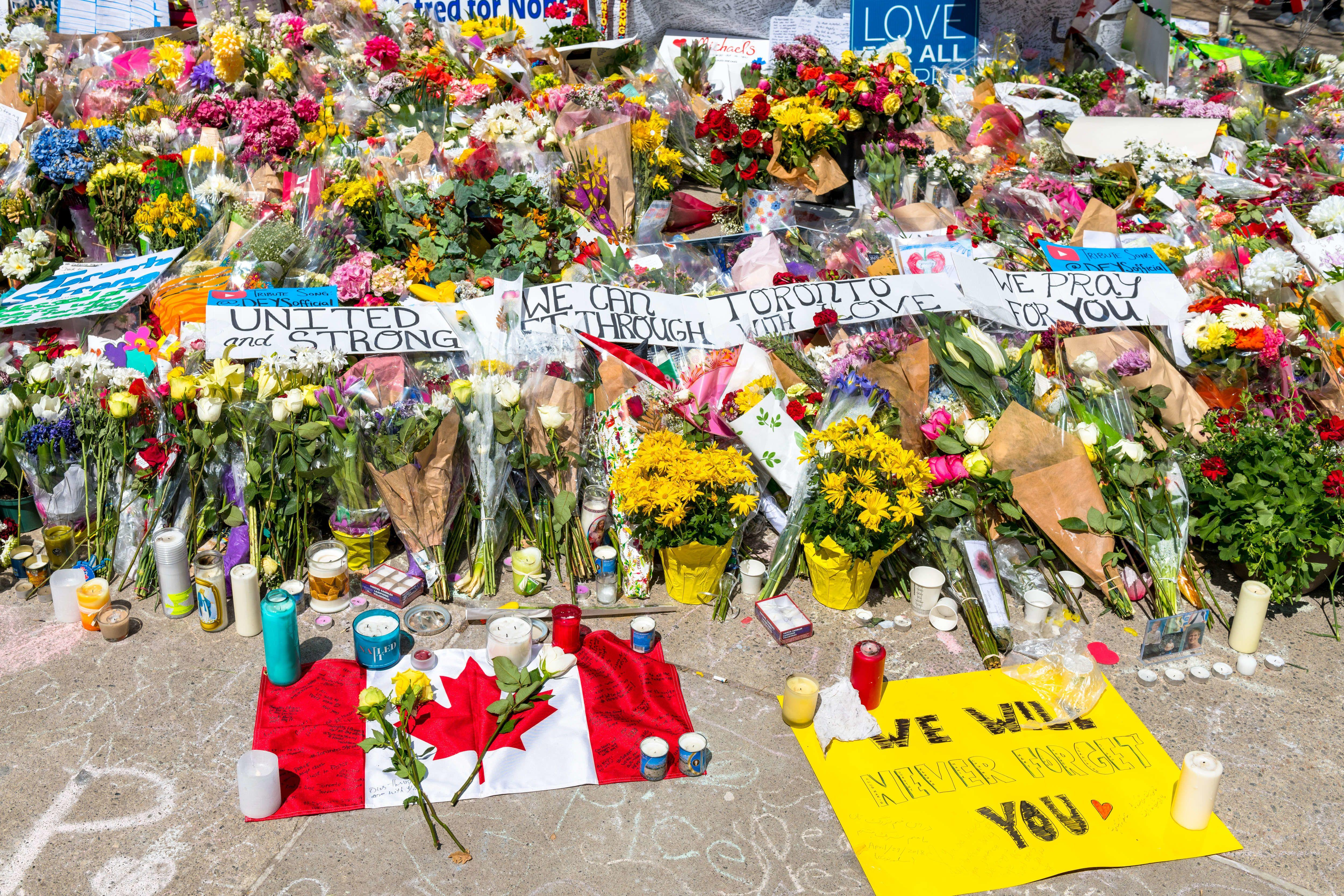 TORONTO, ONTARIO, CANADA - 2018/04/30: Toronto Van Attack a week later: wide angle and aerial view of the memorial in Mel Lastman square. There is a Canadian flag at the front. (Photo by Roberto Machado Noa/LightRocket via Getty Images)