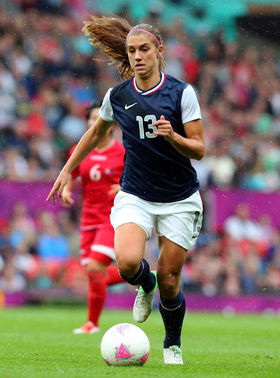 Alex Morgan of United States runs with the ball during the Women's Football first round Group G match between the United States and DPR Korea,on Day 4 of the London 2012 Olympic Games at Old Trafford on July 31, 2012 in Manchester, England. (Photo by Stanley Chou/Getty Images)