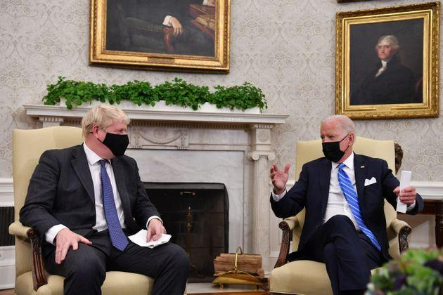 Biden with Johnson in the Oval Office (Photo: NICHOLAS KAMM via Getty Images)
