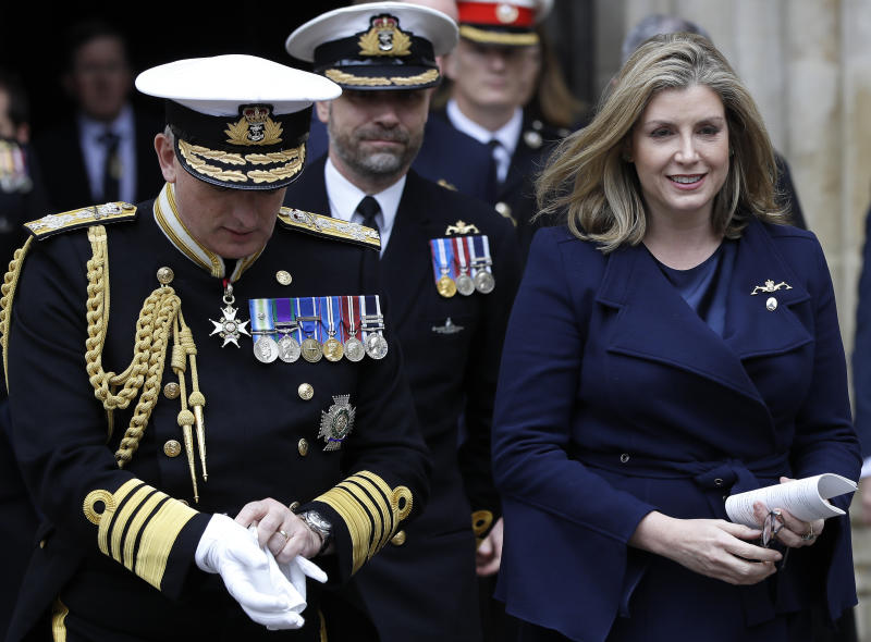 Britain's newly appointed Secretary of State for Defence Penny Mordaunt, right, leaves after attending a service to recognise fifty years of continuous deterrent at sea, at Westminster Abbey in London, Friday, May 3, 2019. Royalty, politicians and military chiefs are gathering at Westminster Abbey to mark half a century of Britain's sea-borne nuclear arms program _ though organizers insist they are not thanking God for atomic weapons. (AP Photo/Kirsty Wigglesworth, Pool)