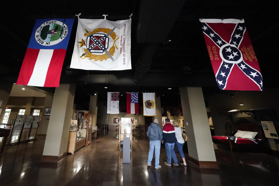 Visitors view exhibits at the National Confederate Museum on June 6, 2021, in Columbia, Tenn. With the approval of relatives, the remains of Confederate Gen. Nathan Bedford Forrest will be moved from Memphis, Tenn., to the museum. (AP Photo/Mark Humphrey)