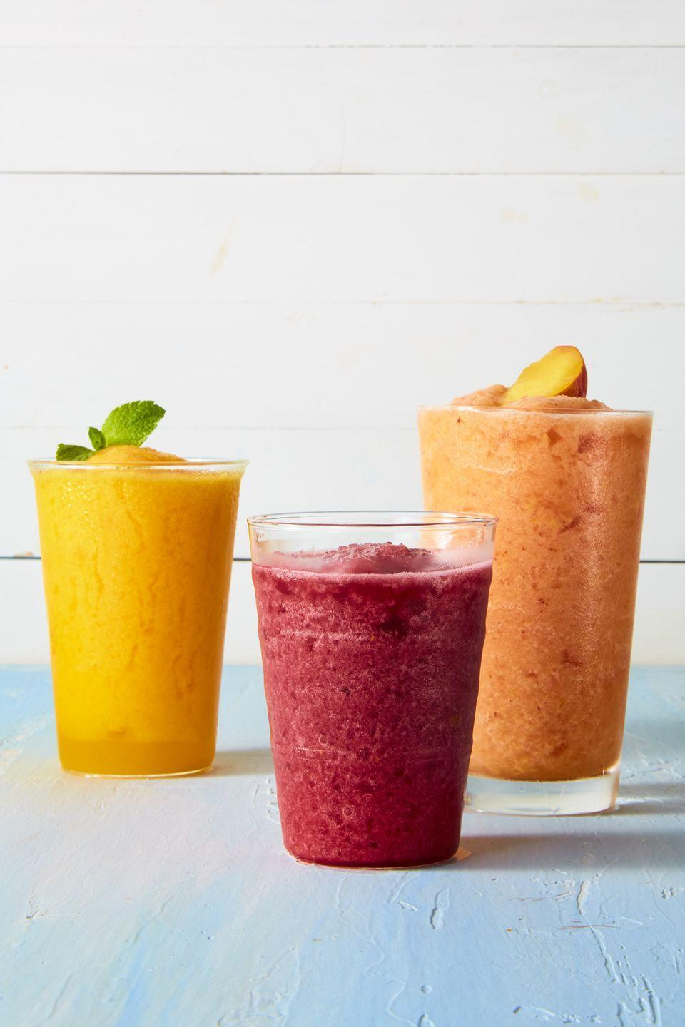 """<p>Beat the inevitable heat with a frozen thirst-quencher. If you're looking for something more tropical, try <a href=""""https://www.goodhousekeeping.com/food-recipes/a44687/mango-limeade-slushies-recipe/"""" rel=""""nofollow noopener"""" target=""""_blank"""" data-ylk=""""slk:this mango version"""" class=""""link rapid-noclick-resp"""">this mango version</a> instead. </p><p><em><a href=""""https://www.goodhousekeeping.com/food-recipes/a44684/raspberry-limeade-slushies-recipe/"""" rel=""""nofollow noopener"""" target=""""_blank"""" data-ylk=""""slk:Get the recipe for Raspberry Limeade Slushies »"""" class=""""link rapid-noclick-resp"""">Get the recipe for Raspberry Limeade Slushies »</a></em></p>"""