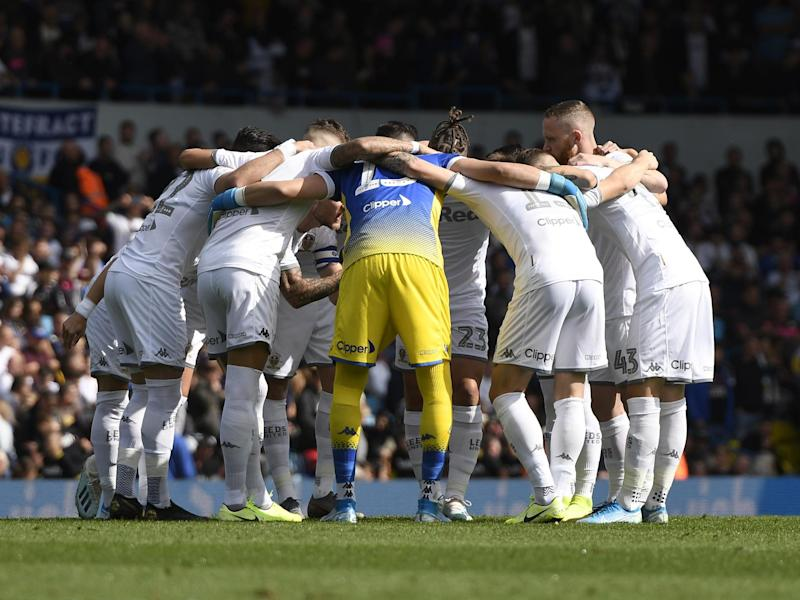 The Leeds United team in a huddle: Getty Images