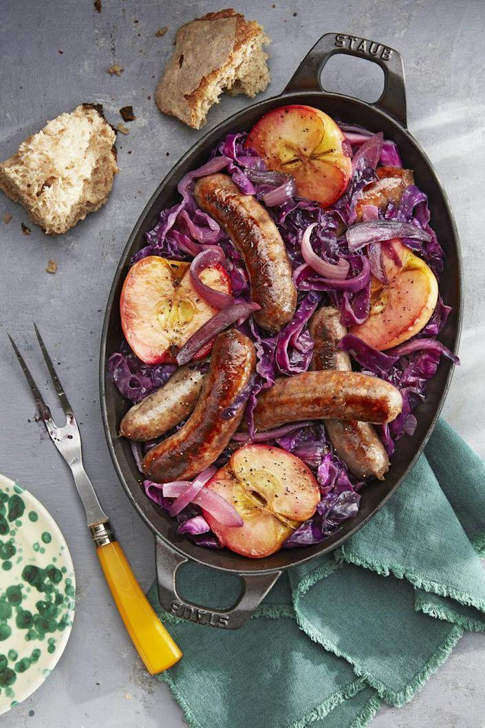 """<p>Fill up on all the flavors of fall with this recipe slightly sweetened with fresh apple cider.</p><p><strong><a href=""""https://www.countryliving.com/food-drinks/a23336101/seared-sausage-with-cabbage-and-pink-lady-apples-recipe/"""" rel=""""nofollow noopener"""" target=""""_blank"""" data-ylk=""""slk:Get the recipe"""" class=""""link rapid-noclick-resp"""">Get the recipe</a>.</strong></p><p><strong><a class=""""link rapid-noclick-resp"""" href=""""https://www.amazon.com/Staub-1303323-Baking-12-5x9-inch-Black/dp/B000I7GSE2/?tag=syn-yahoo-20&ascsubtag=%5Bartid%7C10063.g.35055779%5Bsrc%7Cyahoo-us"""" rel=""""nofollow noopener"""" target=""""_blank"""" data-ylk=""""slk:SHOP CAST IRON BAKING DISH"""">SHOP CAST IRON BAKING DISH</a><br></strong></p>"""