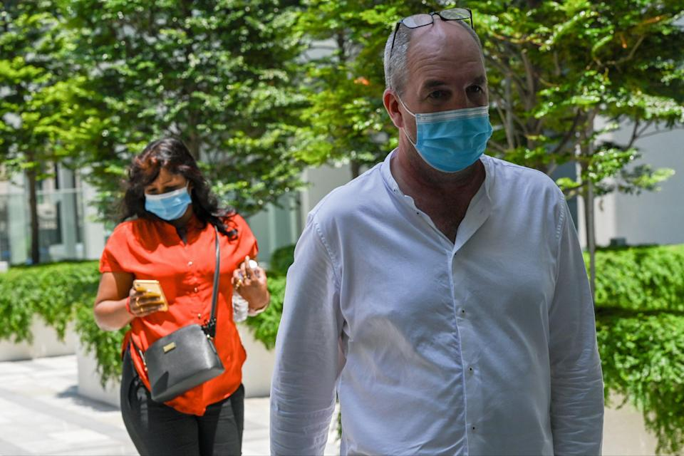 British national Nigel Skea (R) and wife Agatha Maghesh Eyamalai arrive at the State Court in SingaporeAFP via Getty Images